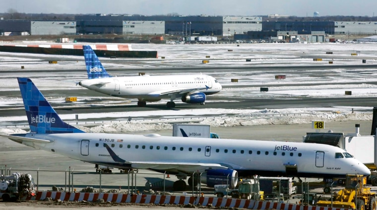 A JetBlue aircraft makes its way from the terminal at JFK International Airport in New York