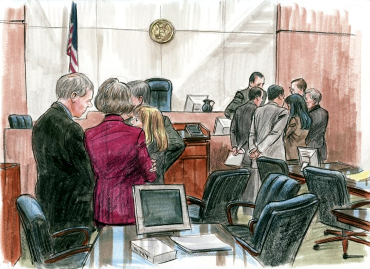"""Lawyers for the government, left foreground, and the defense, right background, discuss, on Mar. 5, 2006, how to respond to questions from the jurors in the I. Lewis """"Scooter"""" Libby trial."""