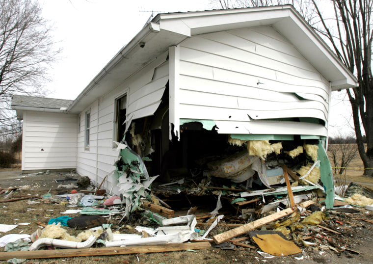 Vivian Pace's home in Bedford, Ind. is pictured on Tuesday. Eric Johnson crashed his rented Cessna into his former mother-in-law's southern Indiana home, police said, killing himself and his 8-year-old daughter, Emily Johnson.