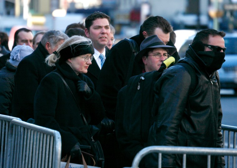 People huddle against the cold as they wait at a taxi stand in New York City on Tuesday. Strong winds and fierce cold madefor frostbite conditions in upstate New York, while in the city the temperature was expected to reach a high of 22 degrees.