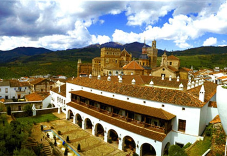 The Parador de Guadalupe, 150 miles southwest of Madrid, is set in the mountainous center of the Iberian Peninsula, and is the former Hospital of St. John the Baptist.
