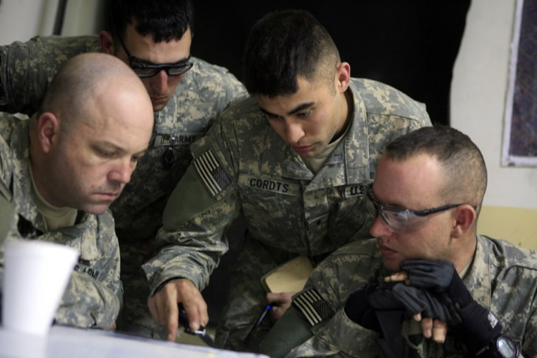 Lt. Eroch Cordts, 24, second right, Sfc. David Horn, 36, left, Sgt. Chase Decker, 23, second left and Staff Sgt. Ryan Stringfellow, 32, right, plan a joint foot patrol with the Iraqi Army and Iraqi National Police in the Shiite enclave of Sadr City in Baghdad, Iraq, Wednesday.