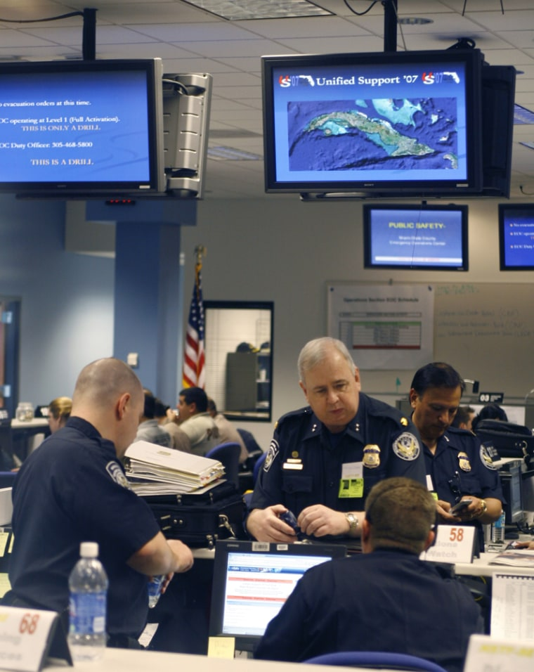 Federal and state officials man the Miami-Dade Emergency Operations Center on Wednesday in Doral, Fla., as they begin a two-day training exercise to prepare for a potential mass migration from the Caribbean, such as the one that could occur when Cuban President Fidel Castro dies.