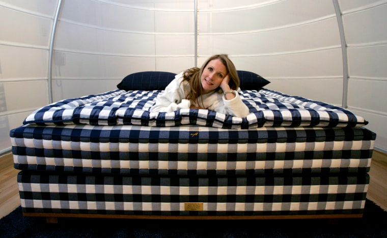 Mary Pat Wallace, owner of Hastens in Chicago, poses on a Vividus ultra-luxe bed, which the Swedish firm launchedlast year. It costs an eye-opening $49,500.
