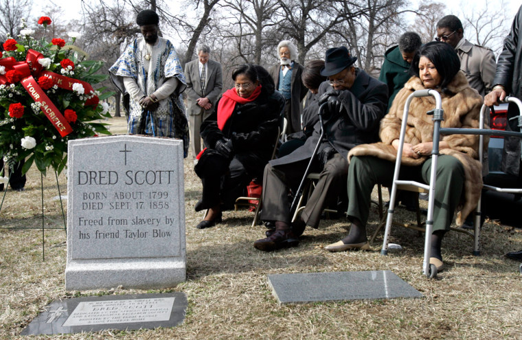 Descendants of Dred Scott and others gather at his grave site Tuesday inSt. Louis, Mo., to mark the 150th anniversary of the Supreme Court's decision to deny Scott, a slave,his freedom.