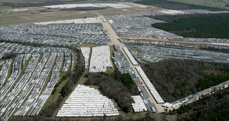 Some of the approximately 20,000 mobile homes and trailers owned by FEMA await sale at the Hope Municipal Airport near Hope, Ark., on March 2.