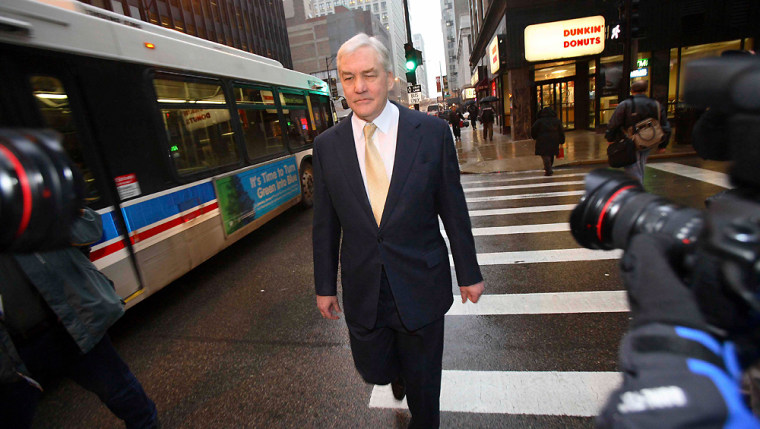 Former newspaper magnate Conrad Black leaves federal court after a status hearing in Chicago
