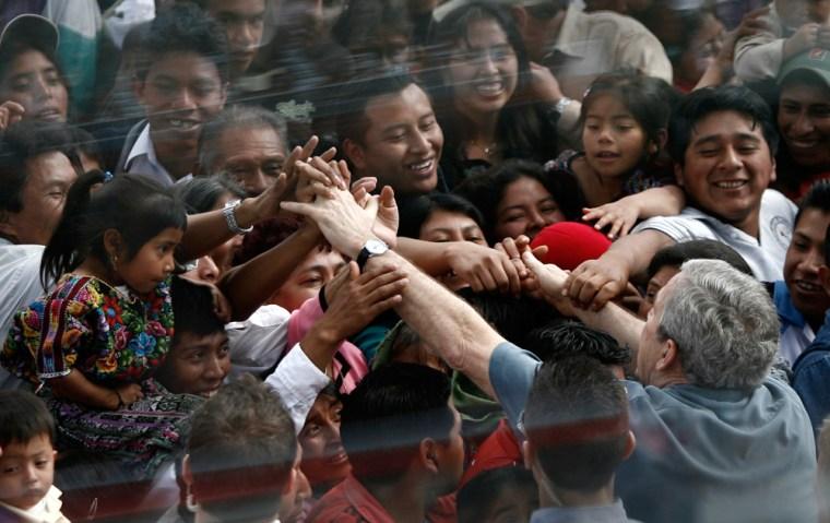 U.S. President George W. Bush greets villagers in Santa Cruz Balanya