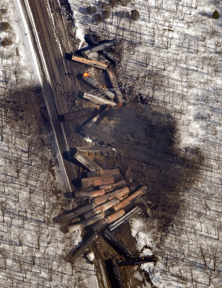 Freight train cars are strewn along railroad tracks in Oneida, N.Y., after an explosion on Monday.