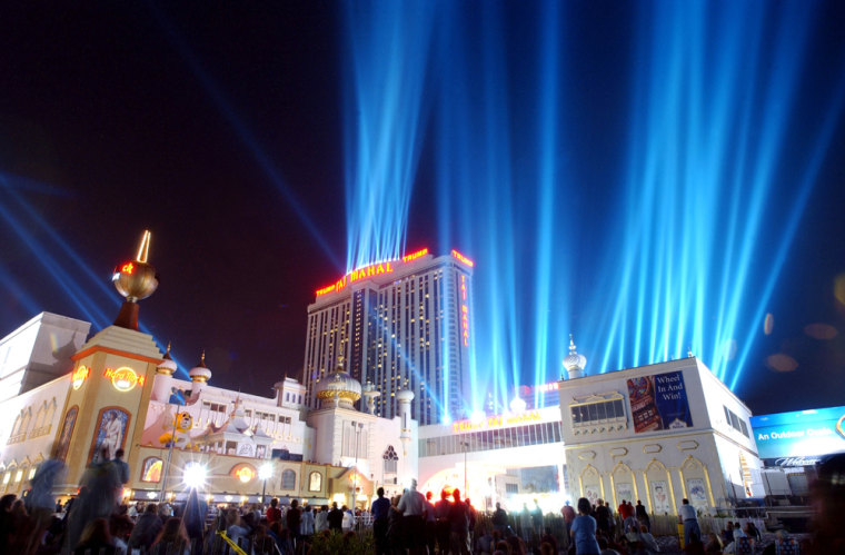 Spectators watch Lights of Freedom at the Trump Taj Mahal in Atlantic City, N.J. The casino company that bears Donald Trump's name said Monday it has hired an investment firm to help it explore its strategic alternatives.