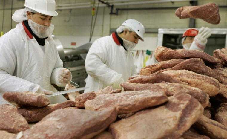 Butchers grab from piles of beef, at Vienna Beef Ltd. earlier this month as the Chicago meat company gears up for the St. Patrick's Day rush.