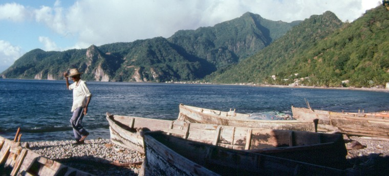 Afisherman walks on Soufriere Bay in Dominica. This jagged, densely rainforested island, about 29 miles long and 16miles wide, is located between Guadeloupe and Martinique in the Eastern Caribbean, 375 miles southeast of San Juan, Puerto Rico.