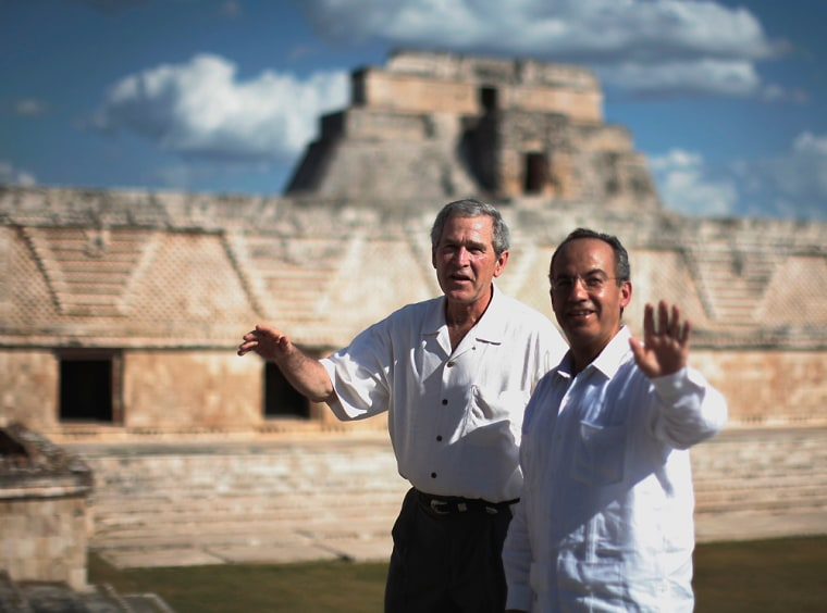 U.S. President George W. Bush and Mexico's President Calderon tour the Mayan ruins in Uxmal