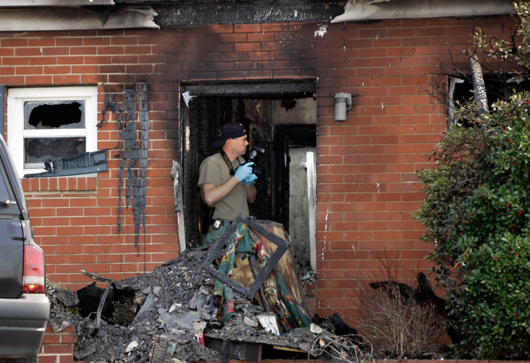 Investigators examinedamage Tuesdayfrom a fire at the Davie Place Residential Care facility in Mocksville, N.C.
