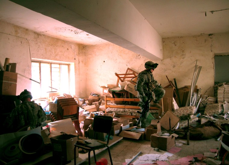 Members of the U.S. Army's 5th Battalion search an abandoned school in Baqouba, Iraq,on Wednesday. The unit _ a Stryker battalion _ was sent from Baghdad to Diyala province this week to help quell increasing violence there.