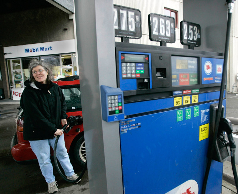 Patti O'Connor pumps gas at a Mobil gas station in Cambridge, Mass.
