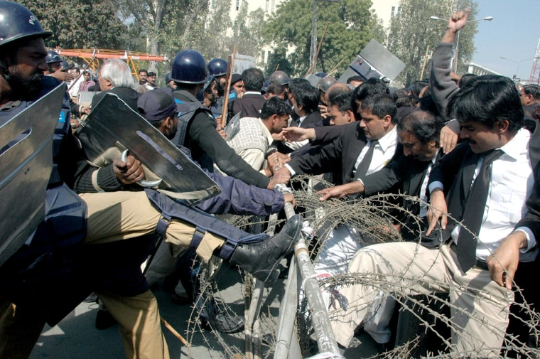 Pakistani lawyers scuffle with police during an anti-government rally in Lahore, Pakistan, on Friday.