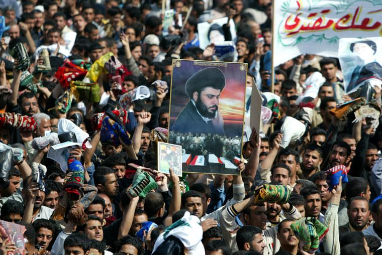 Iraqi Shiite Muslims waving their prayer