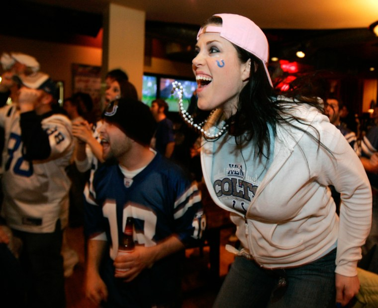 Indianapolis Colts football fan Kellie Nowacki reacts at Jillian's in downtown Indianapolis, Sunday, Feb. 4, 2007, following an interception for a touchdown by the Colts against the Chicago Bears in Super Bowl XLI being played in Miami.