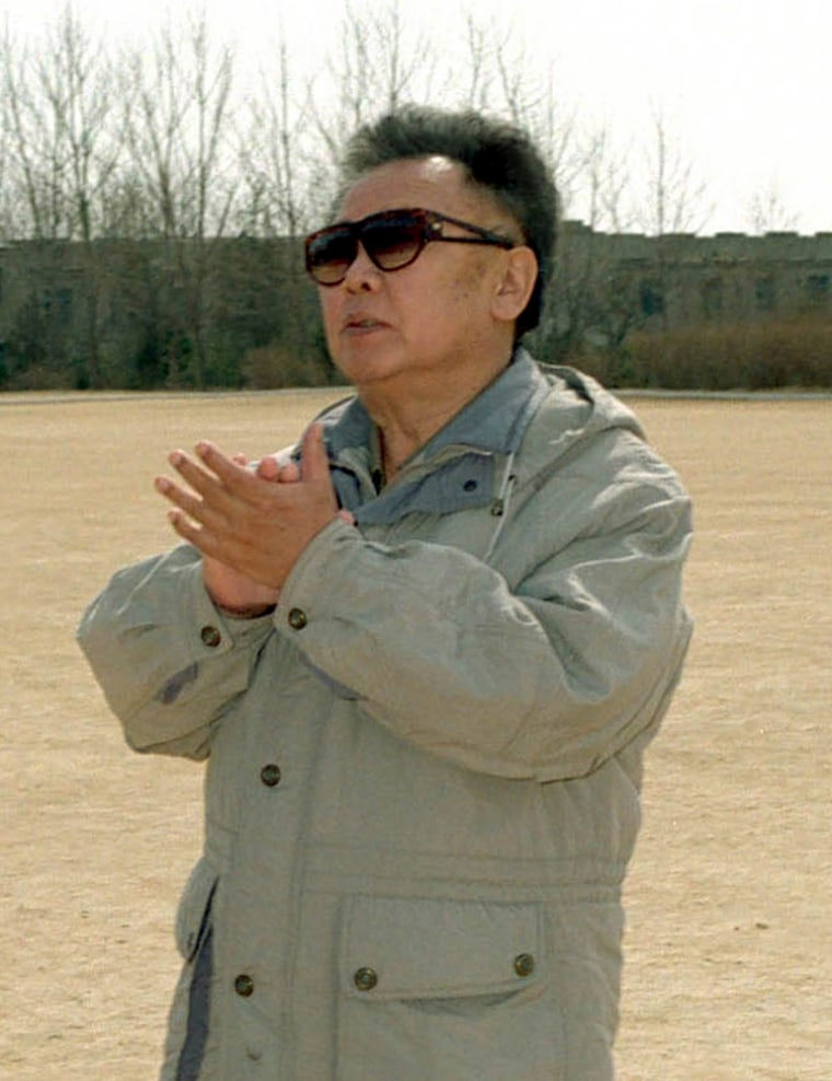 North Korean leader Kim Jong Il applauds after a salute from servicemen during his inspection of the Command of Guard Seoul Ryu Kyong Su 105 Tank Division. The date and place were not disclosed by the sources.