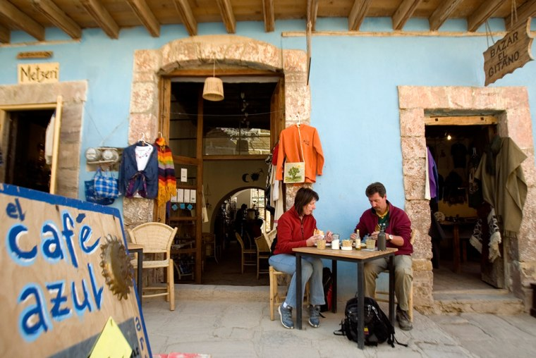 Tourists eat breakfast at a coffee shop in the old mining town of Real de Catorce, Mexico. If traveling by land or boat, youneed only a driver's license or birth certificate.