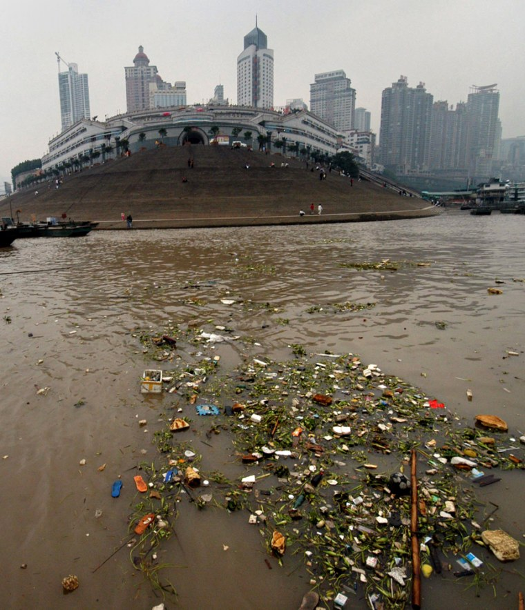 Rubbish float on the Yangtze River in southwest China's Chongqing Municipality section
