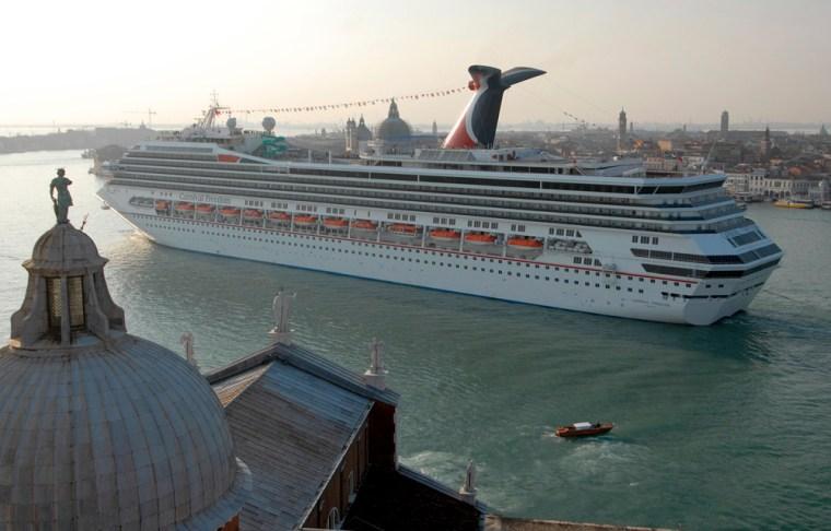 The new Carnival Freedom sails by San Giorgio Maggiore church in Venice, Italy