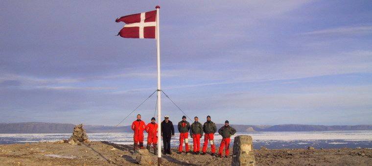 The crew of the Danish warship Vedderenraise Denmark's flag on the disputedHans Island off Greenland in this Aug. 13, 2002, file photo.
