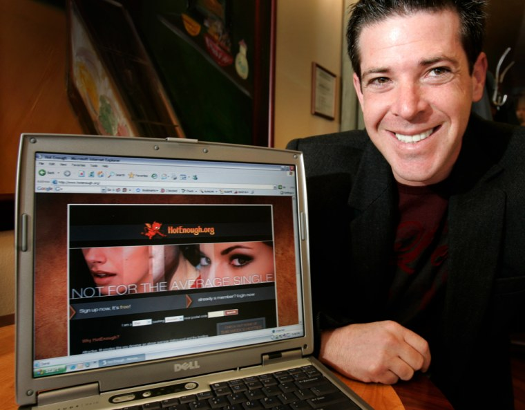 """Jason Pellegrino, 33, who runs a dating website called """"HotEnough.org"""" poses with the site's home page in South Orange, N.J., Tuesday, March 6, 2007. Prospective members of the website must submit pictures and must be rated an 8 or higher by people already in the club. Once they're in, they are permitted to e-mail other """"hotties"""" for $9.95 a month."""