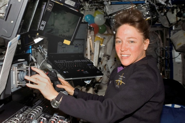 Former astronaut Lisa Nowak, shown here during last July's flight of the shuttle Discovery, has been given the job of developing flight lesson plans for the U.S. Navy. NASA fired Nowak, a Navy captain,after she was arrested on suspicion of assaulting a romantic rival.