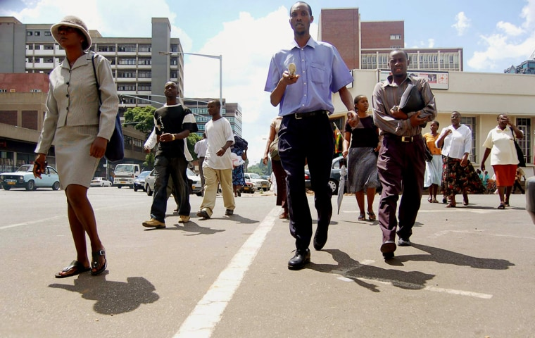 Pedestrians walk along a street of Harar
