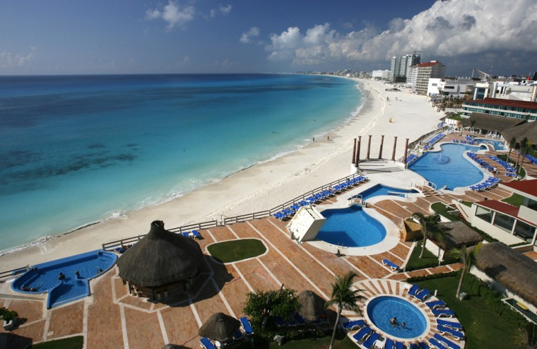 A view of the beach in Cancun, Mexico. Cancun's new beach, built by pumping 96 million cubic feet (27 million cubic meters) of sand from the ocean floor, is the highlight of an extreme makeover the resort has gone through since it was savaged by Hurricane Wilma on Oct. 21, 2005.