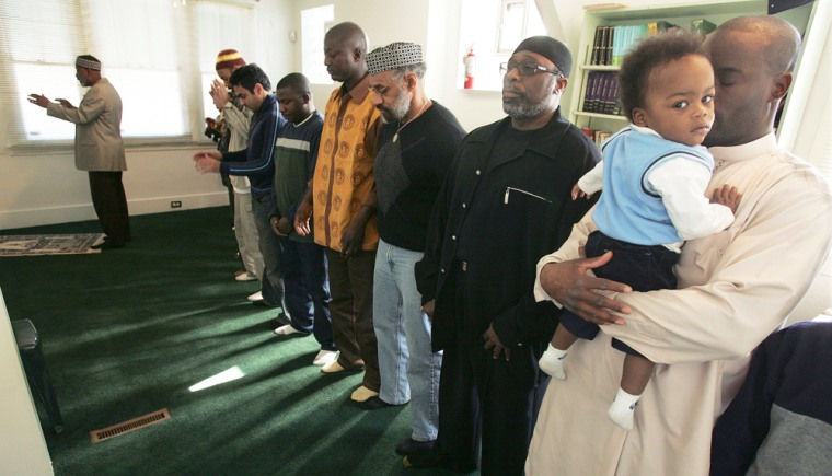 Muslim men gather at Masjid al-Mumin mosque for Friday prayers in Pittsburgh on March 9. Following whatseems to be a trend in cities nationwide, religious leaders inthat city and othershave indicated an increase in black conversions to Sunni Islam since Sept. 11.