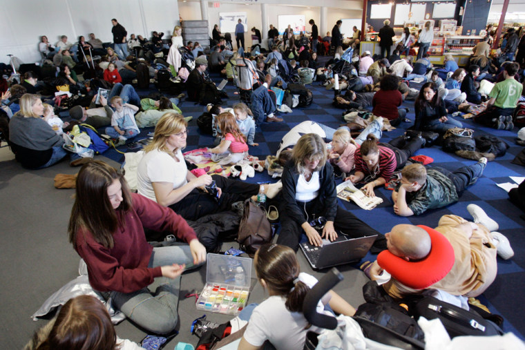 JetBlue Airways Corp. passengers fill the terminal floor as they wait for flights at New York's JFK earlier this year.