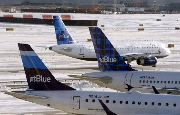 Jet Blue airplanes are see at JFK Airport in New York