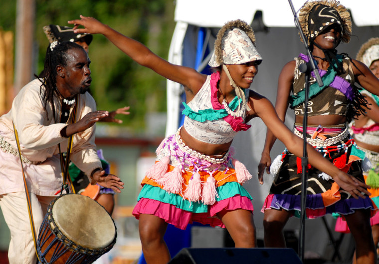 Islanders perform Sundayduring a cultural show to mark the beginning of a year-long commemoration of the abolition of the trans-Atlantic slave trade in the British Empire.