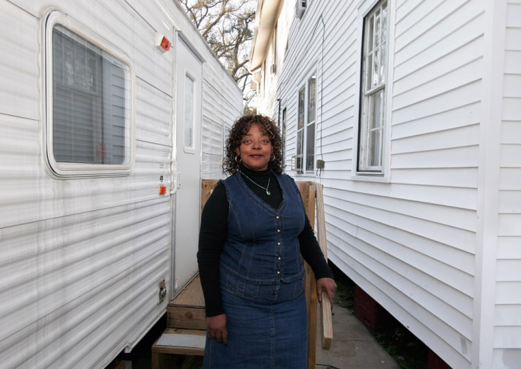 Joyce Ridgeway living in a FEMA trailer next to her New Orleans home. She is still waiting for her final settlements from Lloyd's.