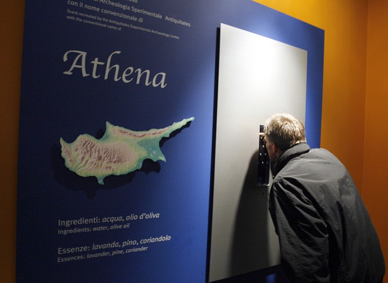 A man stoopsto sniff an ancient perfumeon display at the Capitoline Museums in Rome.The exhibit features four perfumes recreated by a team of archaeologists from 14 original fragrances dating to 4,000 years ago.