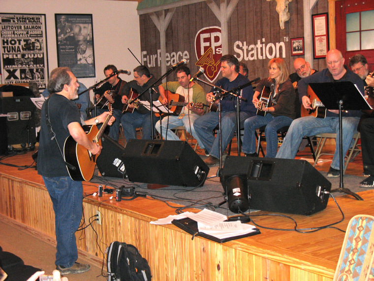 """Students in Jorma Kaukonen's class often work on one particular song, then perform it together. Here Jorma leads his students in a rousing rendition of """"Keep On Truckin'."""""""