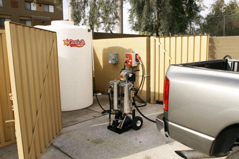 A pickup truck is refueled with a mix that includes usedvegetable oil. The system is being used bya company that owns 52 Carl's Jr. franchises in Arizona.