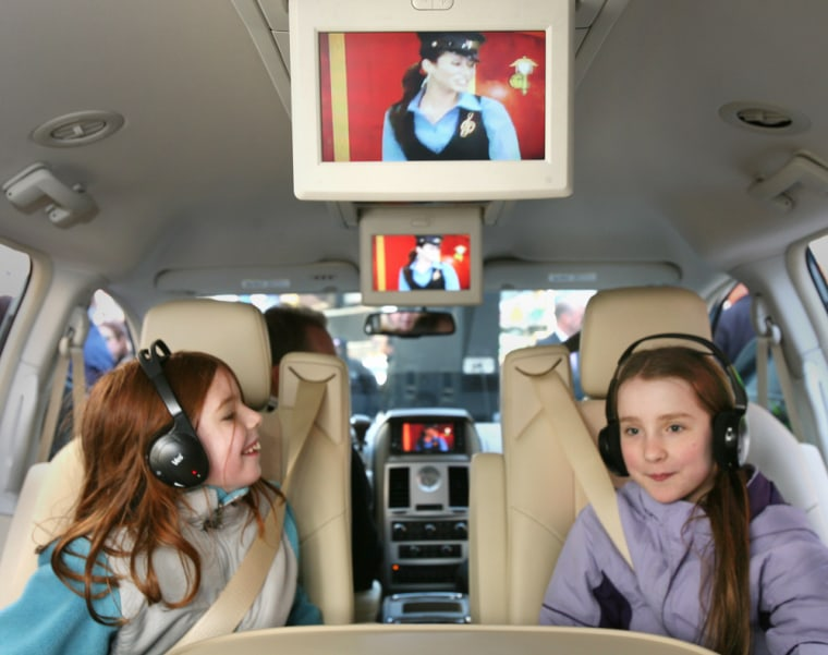 Willa Norris, 8, left, and Hannah Fowler, 10, take in a demonstration of the new Sirius Backseat TV service in a 2008 Chrysler Town and Country minivan. The service will be exclusive to Chrysler for the first year.