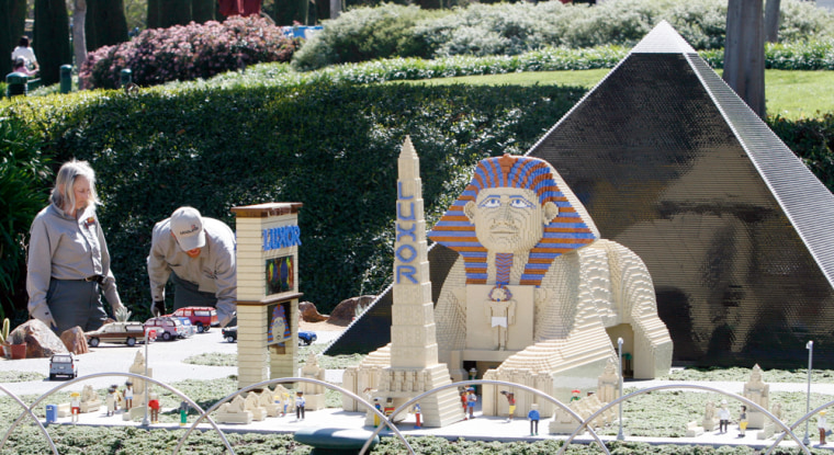 Workers put the finishing touches on a reproduction of the Luxor Hotel in the new mini-land exhibit at Legoland in Carlsbad, Calif.