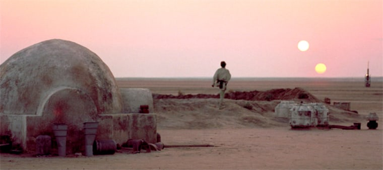 "Luke Skywalker surveys a double sunset on the planet Tatooine in ""Star Wars: A New Hope."""