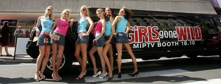 """""""Girls Gone Wild"""" models pose in front of the Cannes Festival Palace last year in Cannes, France. Now the video series' creator thinks raunch and lunch go well together."""
