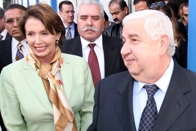 Syrian Foreign Minister Walid Moallem walks Tuesday with House Speaker Nancy Pelosi, after welcoming her to Damascus International Airport. Pelosi is the highest ranking U.S. official to visit Syria since 2003.