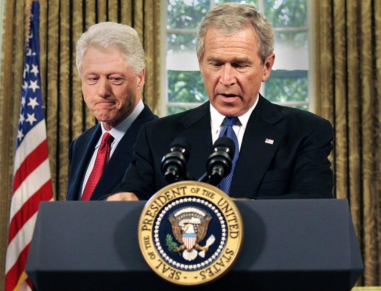 Former US President Bill Clinton (L) loo