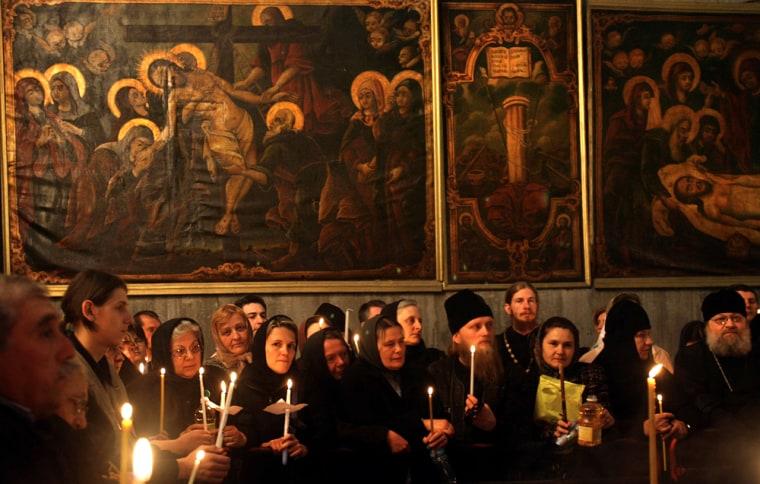 Christian Orthodox pilgrims attend a spe