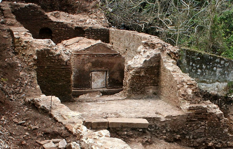 Archaeologists have discovered a Roman-era grave complex on the western Greek island of Kefallonia. The large, house-shaped grave (center)has astone door that still works perfectly.