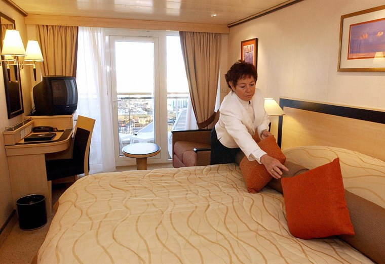 A chamber maid prepares a cabin aboard t