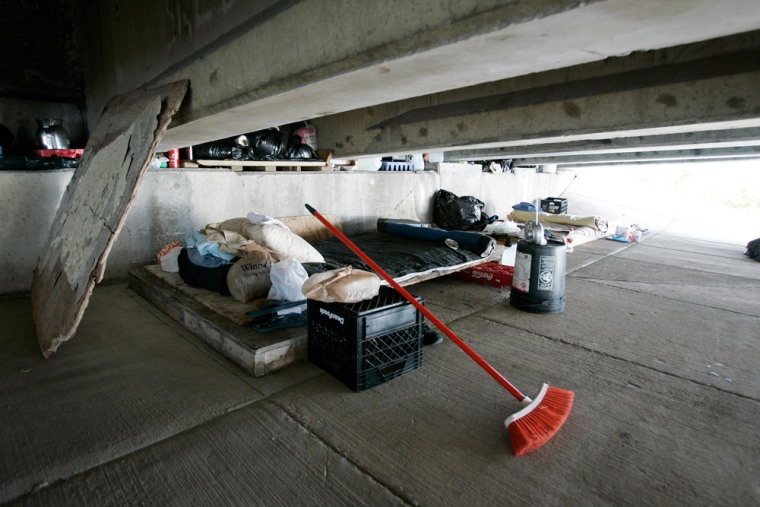 Two paroled sex offenders living under a bridge beside the intercoastal waterway in Miami keep their area tidy.